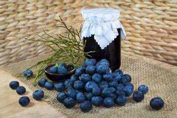 Still life with blueberries, confection, jam and twigs