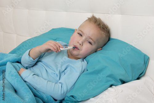 little boy with a thermometer