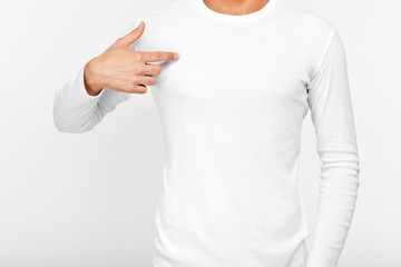 Close-up of a man pointing his fingers on a blank t-shirt