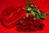 Roses and a red heart box on a red background