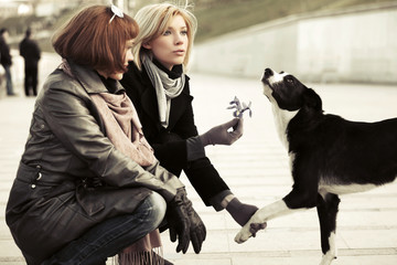 Two young women and a dog