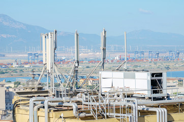 Industrial refrigeration equipment on the roof.
