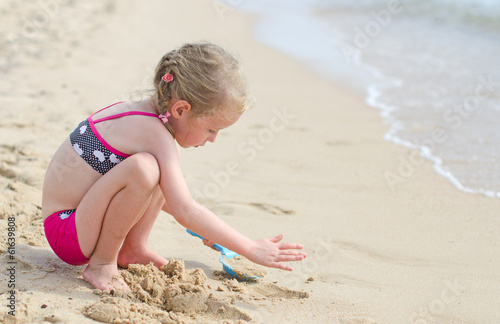 Little girl playing on the beach.