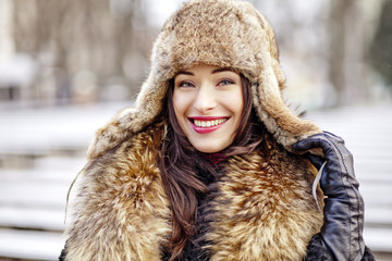 Girl smiling in fur hat and coat