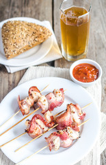 Grilled bacon skewers with chicken meat