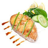 Fish dish -fried fish fillet with vegetables on white background