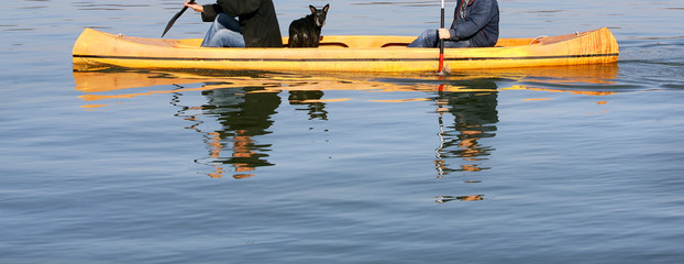 Two Rowers and a Dog