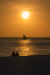 Couple in love with Scenic view of sunset in Zanzibar