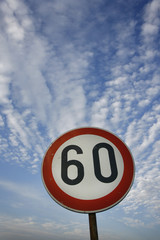 road sing speed limit on sixty