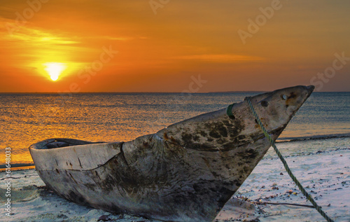 Scenic view of sunset in Zanzibar with typical Zanzibarian canoe