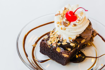 Chocolate brownie icecream and cherry