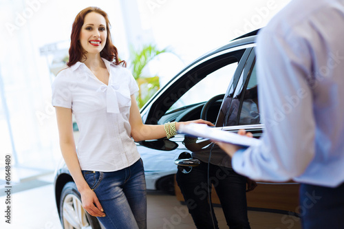 Young woman at car salon