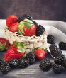 Fresh strawberries and blackberries in basket