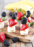 Fresh fruits on the skewers. Shallow depth of field