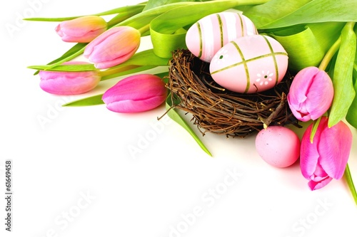 Easter nest with painted eggs and vibrant tulip flowers