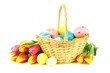 Tulips and Easter basket filled with colorfully painted eggs