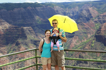 Happy family on the observation deck of Waimer Canyon. Hawaiian