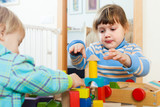 sibling playing in blocks