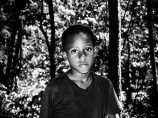 caribbean boy in the woods