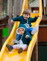happy children on slide at playground