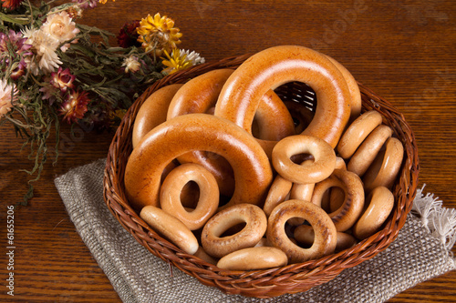 large and small bagels in basket