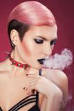 Girl blows smoke.