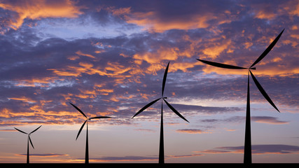 Wind turbine silhouette sunset or sunrise economic system backg