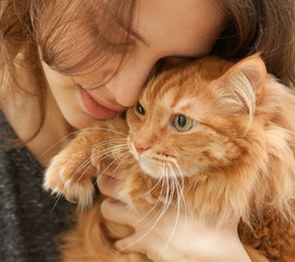 portrait of beautiful young woman 20 years with a fluffy red ca