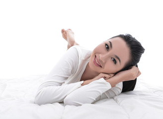 Beautiful woman Portrait of smiling lying in bed