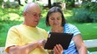 Senior couple with digital tablet pc