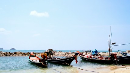fishing boats lie down on a tropical beach
