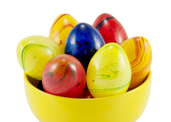 Ceramic easter eggs in the yellow bowl
