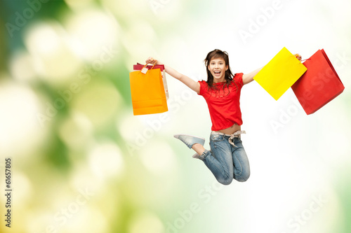 excited girl with shopping bags