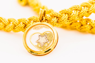 gold pendant and braid bracelet