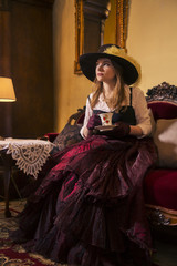Woman at dress with cup of tea