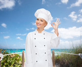 smiling female chef showing ok hand sign