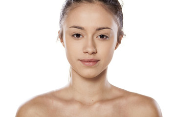 young woman with just a foundation on her face