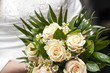canvas print picture - Wedding bouquet in hands of the bride