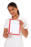 Attractive indian woman points at clipboard