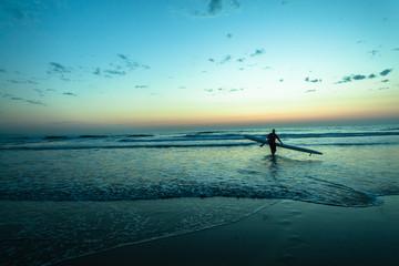 Dawn Ocean Surf-Ski Paddlers