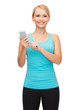 sporty woman with smartphone
