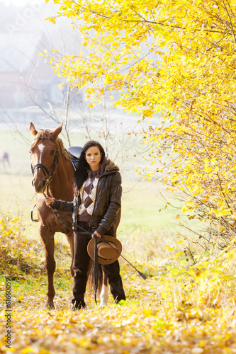 canvas print picture equestrian with her horse in autumnal nature