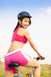Smiling woman biker riding Folding Bicycle in outdoor