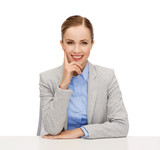 smiling businesswoman sitting at table