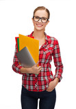 female in eyeglasses with folders and tablet pc