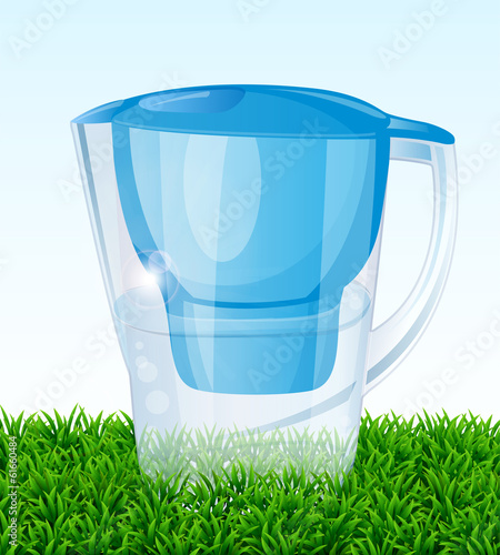 Jug filter for water on green grass