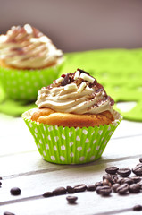 Tasty cupcakes with butter cream