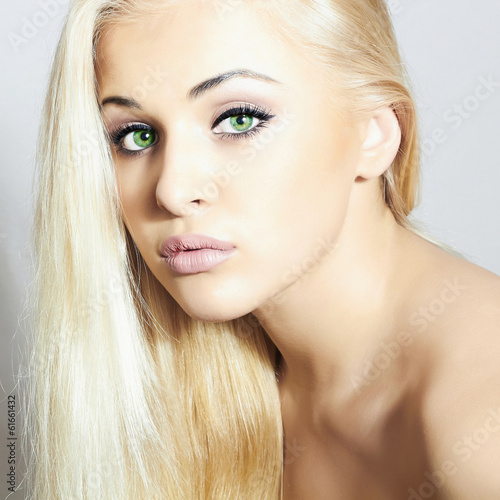 Romantic Beautiful Woman with green eyes.Beauty Sexy Blond Girl