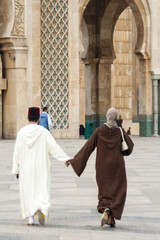 Muslim man and Woman hand with hand Go to Mosque Casablanca