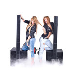 Two sexy girls posing with audio equipment